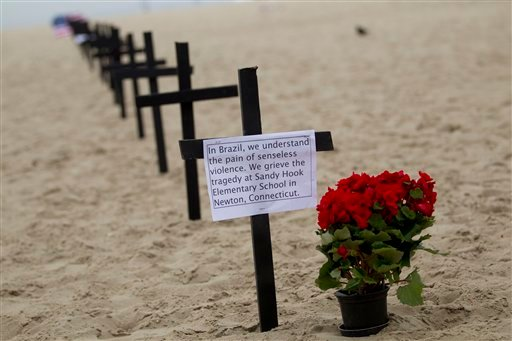 © Crosses are set at the Copacabana Beach in Rio de Janeiro, Saturday, Dec. 15, 2012, in memory of the school shooting victims in Newtown, Conn. (AP Photo/Silvia Izquierdo)