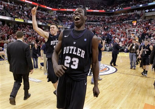 © Butler forward Khyle Marshall (23) and guard Rotnei Clarke celebrate after Butler defeated No. 1 Indiana 88-86 in overtime in an NCAA college basketball game in Indianapolis, Saturday, Dec. 15, 2012. (AP Photo/Michael Conroy)
