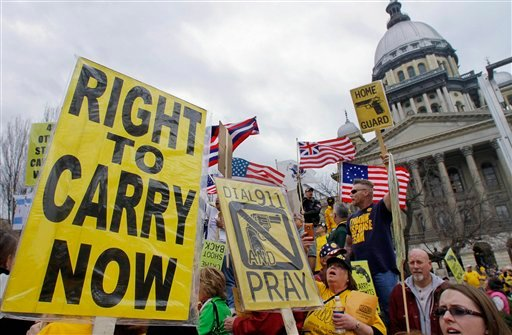 ©  In this March 7, 2012 file photo, gun owners and supporters participate in an Illinois Gun Owners Lobby Day rally at the Illinois State Capitol in Springfield.