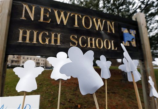 © Angel cut-outs are displayed outside Newtown High School in Newtown, Conn., Sunday, Dec. 16, 2012.