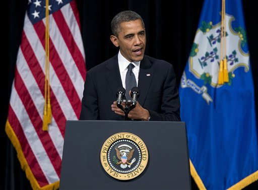 © President Barack Obama speaks during an interfaith vigil for the victims of the Sandy Hook Elementary School shooting on Sunday, Dec. 16, 2012 at Newtown High School in Newtown, Conn.