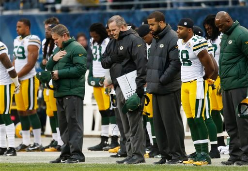 © Green Bay Packers coach Mike McCarthy, center, stands with players and staff during a moment of silence for the victims of Friday's Connecticut elementary school shooting before an NFL football game against the Chicago Bears in Chicago, Sunday, Dec. 16.