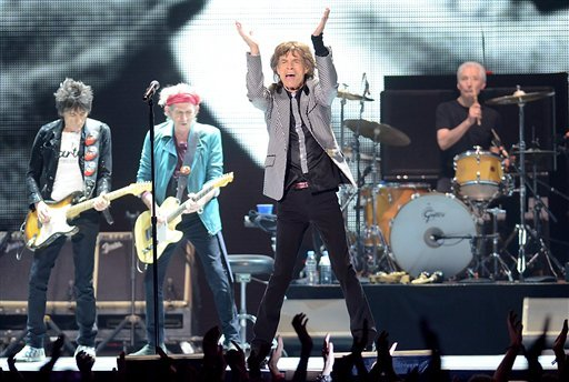 © The Rolling Stones, from left, Ronnie Wood, Keith Richards, Mick Jagger and Charlie Watts perform live at the Prudential Center in Newark, NJ on Saturday, Dec. 15, 2012. (Photo by Evan Agostini/Invision/AP)