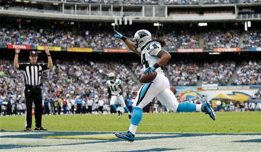 Carolina Panthers running back DeAngelo Williams celebrates as the referee indicates touchdown after his 45 yard reception.
