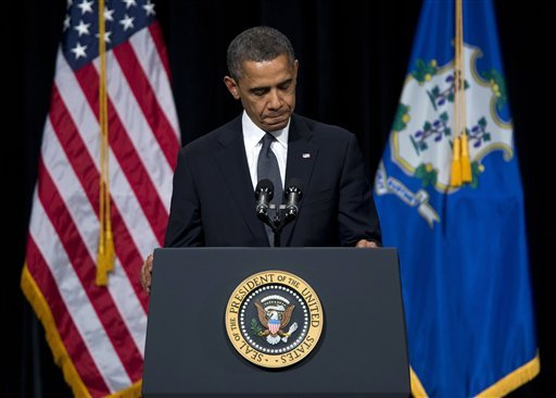 © President Barack Obama pauses during a speech at an interfaith vigil for the victims of the Sandy Hook Elementary School shooting on Sunday, Dec. 16, 2012 at Newtown High School in Newtown, Conn.