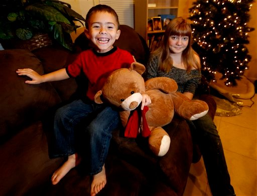 McKenna Pope, 13, right, and her brother Gavyn Boscio, 4, pose for a photo at their home in Garfield, N.J. on Thursday, Dec. 6, 2012. (AP Photo/Julio Cortez)