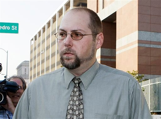 FILE - In this Nov. 1, 2011 file photo, Christopher Chaney, 35, of Jacksonville, Fla., leaves federal court in Los Angeles. (AP Photo/Reed Saxon, File)