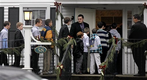 © Mourners arrive for the funeral service of Sandy Hook Elementary School shooting victim, 6-year-old Jack Pinto, Monday, Dec. 17, 2012, in Newtown, Conn.