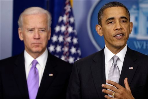 President Barack Obama stands with Vice President Joe Biden as he makes a statement Wednesday, Dec. 19, 2012, in the Brady Press Briefing Room at the White House. (AP Photo/Charles Dharapak)