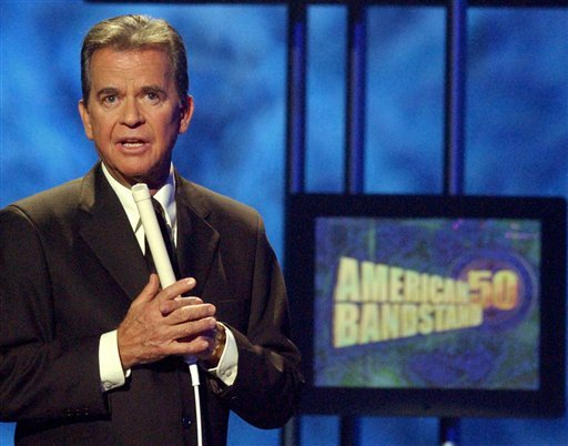 FILE - In this April 20, 2002 file photo, Dick Clark, host of the American Bandstand television show, introduces entertainer Michael Jackson on stage during taping of the show's 50th anniversary special in Pasadena, Calif. (AP Photo/Kevork Djansezian)
