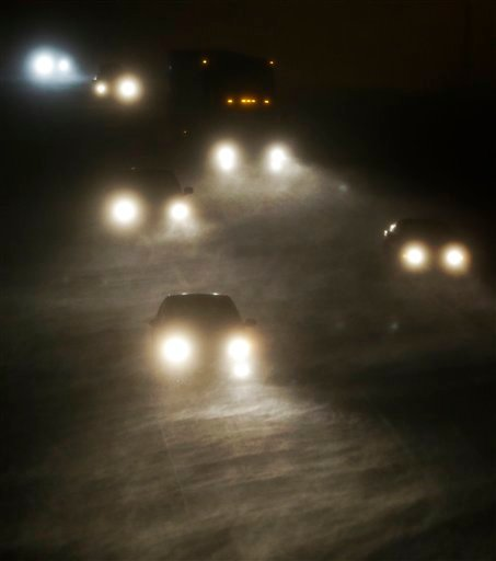 Early morning motorists travel west along I-70 and into a winter storm near Lawrence, Kan., Thursday, Dec. 20, 2012. (AP Photo/Orlin Wagner)