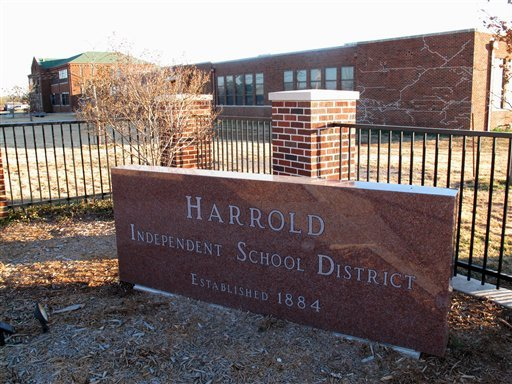 This Monday, Dec. 17, 2012 photo shows the sign in front of the Harrold Independent School District in Harrold, Texas. (AP Photo/Angela K. Brown)