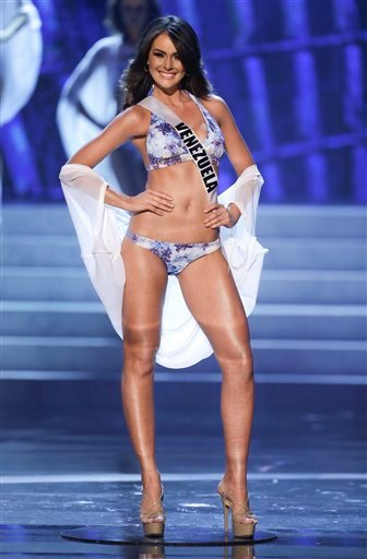 Miss Venezuela, Irene Sofia Esser Quintero, takes center stage as she is named as one of the 10 finalists during the Miss Universe pageant, Wednesday, Dec. 19, 2012, in Las Vegas. (AP Photo/Julie Jacobson)