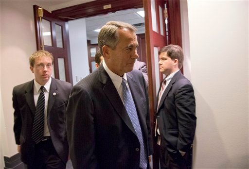 © Speaker John Boehner of Ohio, center, departs after a House Republicans meeting on Capitol Hill, Thursday, Dec. 20, 2012 in Washington.
