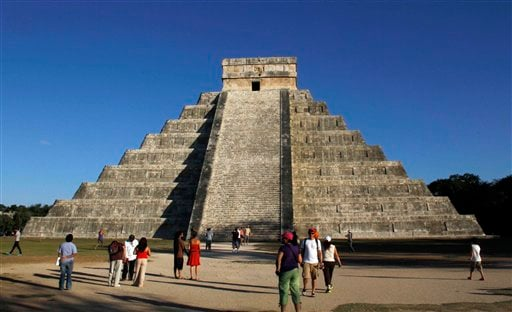  People gather in front of the Kukulkan Pyramid in Chichen Itza, Mexico, Thursday, Dec. 20, 2012.