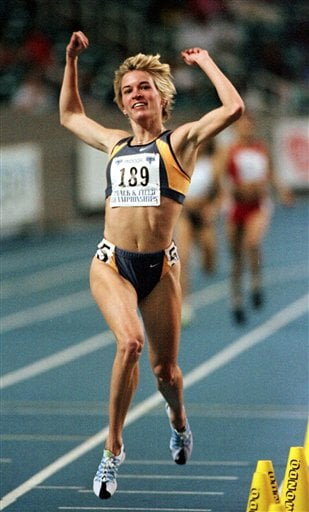 In this Feb. 27, 1999, file photo, Suzy Hamilton reacts after winning the women's 1,500 meter run with a time of 4:13.96 at the USA Championships athletics meet in Atlanta.