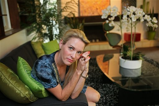 In this photo taken July 17, 2012 Suzy Favor Hamilton poses for a portrait at her home in Shorewood Hills a suburb of Madison, Wis.