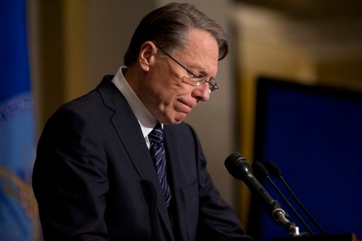 © The National Rifle Association executive vice president Wayne LaPierre pauses as he makes a statement during a news conference in response to the Connecticut school shooting, on Friday, Dec. 21, 2012 in Washington.