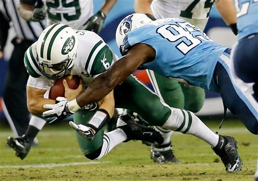 © New York Jets quarterback Mark Sanchez (6) is brought down by Tennessee Titans defensive end Kamerion Wimbley (95) in the second quarter of an NFL football game, Monday, Dec. 17, 2012, in Nashville, Tenn. The Titans won 14-10.