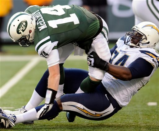 © New York Jets quarterback Greg McElroy (14) is brought down by San Diego Chargers defensive end Corey Liuget during the second half of an NFL football game on Sunday, Dec. 23, 2012, in East Rutherford, N.J.