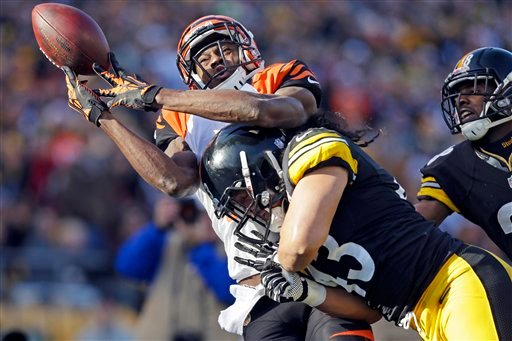 © Cincinnati Bengals wide receiver A.J. Green (18) is hit by Pittsburgh Steelers strong safety Troy Polamalu (43) as he tries to catch a pass in the second quarter of an NFL football game in Pittsburgh, Sunday, Dec 23, 2012.
