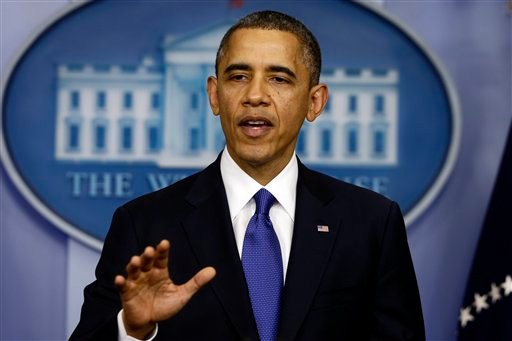 © President Barack Obama speaks to reporters about the fiscal cliff in the Brady Press Briefing Room at the White House in Washington, Friday, Dec. 21, 2012. (AP Photo/Charles Dharapak)