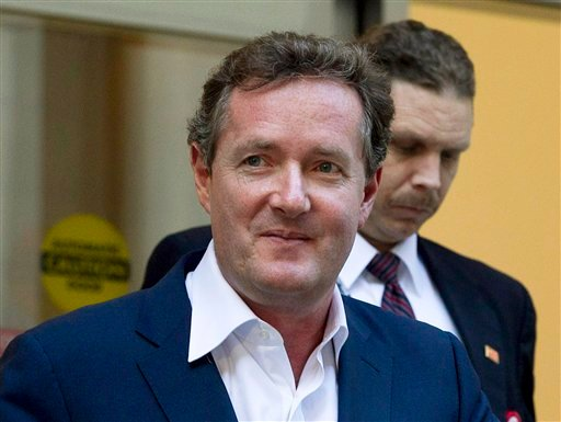 "© In this Dec. 20, 2011 file photo, Piers Morgan, host of CNN's ""Piers Morgan Tonight,"" leaves the CNN building in Los Angeles."