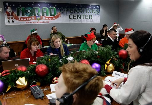 Volunteers take phone calls from children asking where Santa is and when he will deliver presents to their house, during the annual NORAD Tracks Santa Operation, at the North American Aerospace Defense Command, or NORAD. (AP)