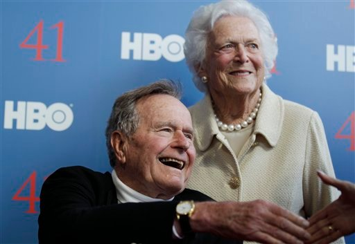 FILE - In a Tuesday, June 12, 2012 file photo, former President George H.W. Bush, and his wife, former first lady Barbara Bush, arrive for the premiere of HBO's new documentary on his life near the family compound in Kennebunkport, Maine. (AP Photo)
