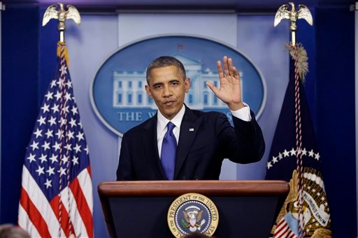 President Barack Obama waves as he leaves the podium after speaking about the fiscal cliff in the Brady Press Briefing Room at the White House in Washington, Friday, Dec. 21, 2012. (AP Photo/Charles Dharapak)