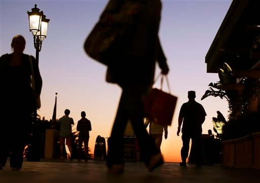 In this Thursday, Dec. 20, 2012 photo, people walk through the Fashion Island shopping center in Newport Beach, Calif. (AP Photo/Chris Carlson, File)