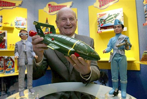 FILE - In this Jan. 27, 2005 file photo, Gerry Anderson, poses for a photograph with a toy Thunderbird 2 on the 40th anniversary of the Thunderbirds first broadcast, in London. (AP Photo/PA, Hugo Philpot, File)