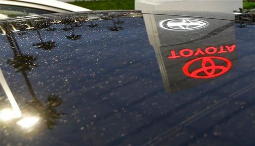 In this Thursday, Nov. 8, 2012, photo, a Toyota dealership signs glows over a car lot in Tustin Calif.  (AP Photo/Chris Carlson, File)