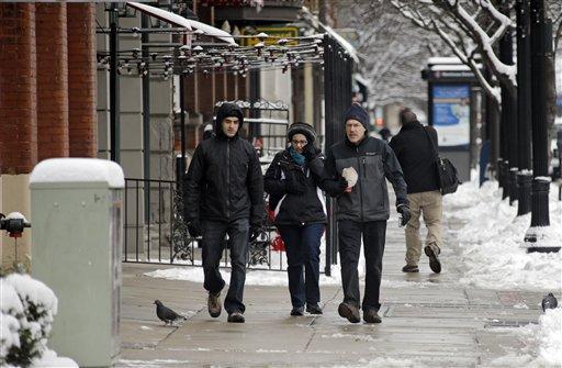 Pedestrians walk down St. Clair Ave. in downtown Cleveland Thursday, Dec. 27, 2012. (AP)