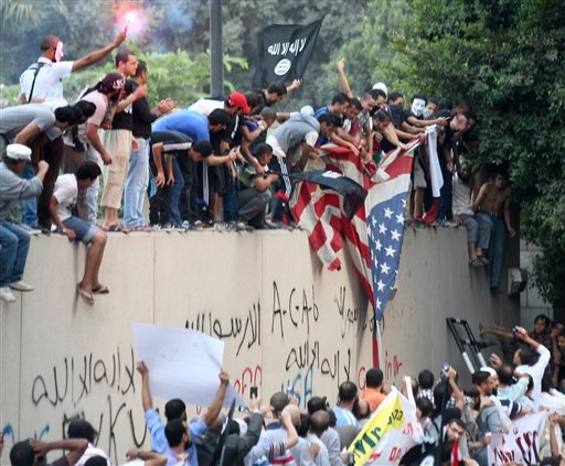 FILE - In this Sept. 11, 2012 file photo, protesters destroy an American flag pulled down from the U.S. embassy in Cairo, Egypt, during a protest of a film deemed offensive of Islam. (AP Photo)