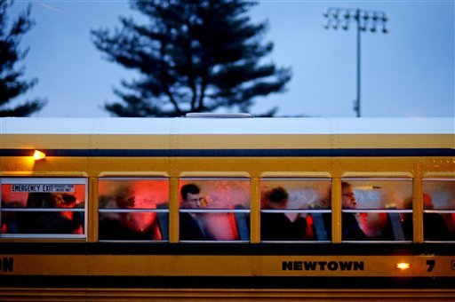 FILE - In this Dec. 16, 2012 file photo, people arrive on a school bus at Newtown High School for a memorial vigil attended by President Barack Obama for the victims of the Sandy Hook Elementary School shooting in Newtown, Conn. (AP)