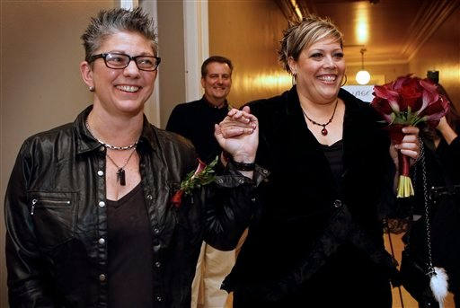 Donna Galluzzo, left, and Lisa Gorney leave the City Clerk's office after obtaining their marriage license, early Saturday, Dec. 29, 2012, at City Hall in Portland, Maine. (AP Photo/Robert F. Bukaty)
