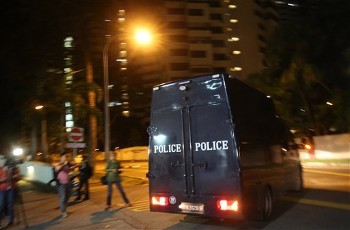 A police hearse leaves Mount Elizabeth Hospital on Saturday Dec. 29, 2012 in Singapore. (AP Photo/Wong Maye-E)