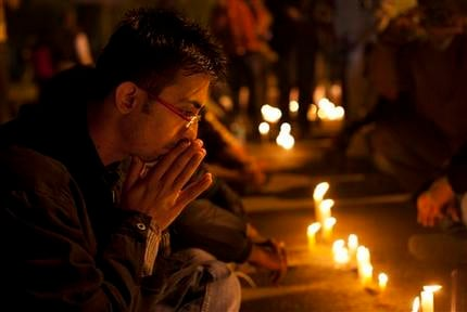 An Indian participates in a candle-lit vigil to mourn the death of a gang rape victim in New Delhi, India, Saturday, Dec. 29, 2012. (AP Photo/ Dar Yasin)