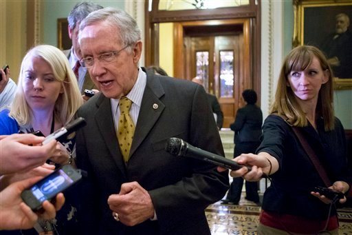 Senate Majority Leader Harry Reid, D-Nev., walks to a closed-door meeting with fellow Democrats. (AP Photo/J. Scott Applewhite)