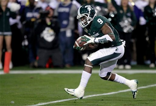Michigan State safety Isaiah Lewis (9) intercepts a pass against TCU during the first half of the Buffalo Wild Wings Bowl NCAA college football game, Saturday, Dec. 29, 2012, in Tempe, Ariz. (AP Photo/Matt York)