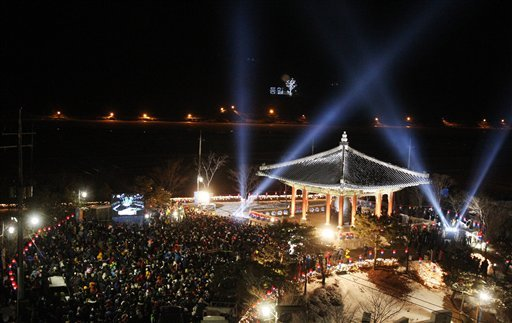 People gather to celebrate the New Year at Imjingak in Paju near the border village of the Panmunjom, South Korea, Tuesday, Jan. 1, 2013. (AP Photo/Ahn Young-joon)