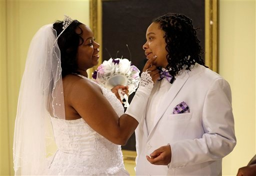 Darcia Anthony, left, and her partner, Danielle Williams, chat before participating in a marriage ceremony at City Hall in Baltimore, Tuesday, Jan. 1, 2013. (AP Photo/Patrick Semansky)