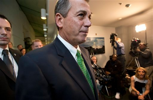 Speaker of the House John Boehner, R-Ohio, passes waiting reporters as he leaves a closed-door GOP meeting on the &quot;fiscal cliff&quot; bill passed by the Senate Monday night, at the Capitol in Washington, Tuesday, Jan. 1, 2013. (AP Photo/J. Scott Applewhite)