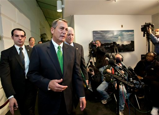 Speaker of the House John Boehner, R-Ohio, walks with House Ways and Means Committee Chairman Dave Camp, R-Mich., following a closed-door GOP meeting. (AP Photo)
