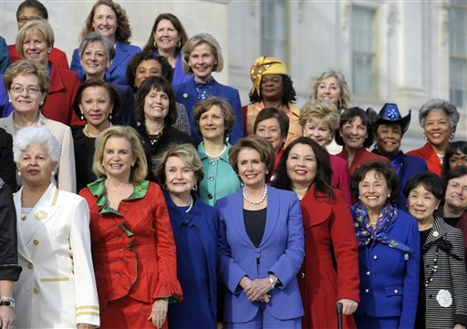 House Minority Leader Nancy Pelosi of Calif., front row, center, poses with other female House members on the steps of the House on Capitol Hill in Washington, Thursday, Jan. 3, 2013. (AP Photo/Cliff Owen)