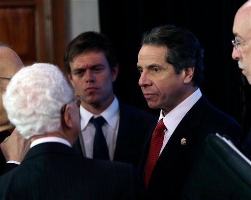 © New York Gov. Andrew Cuomo talks to NYS Responds and NYS Ready Commissions members following a meeting in the Red Room at the Capitol on Thursday, Jan. 3, 2013, in Albany, N.Y.