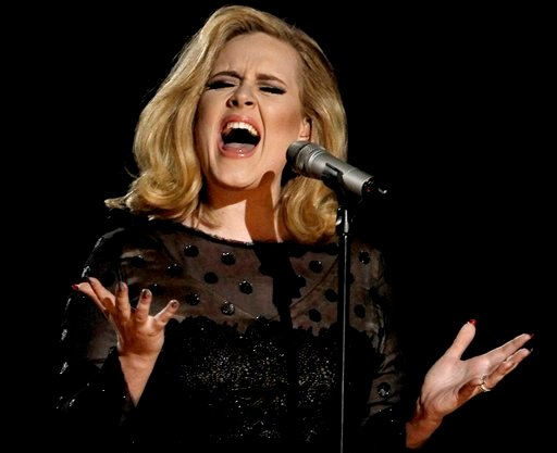 © In this Feb. 12, 2012 file photo, Adele performs during the 54th annual Grammy Awards in Los Angeles.
