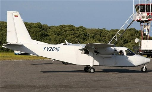 © In this undated photo provided by Venezuela's Ministry of the Interior and Justice Press Office, a plane that went missing sits on the tarmac of the airport in Los Roques, Venezuela.