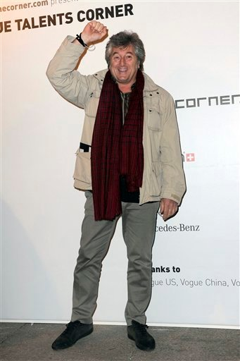 © In this photo taken on Feb. 23, 2010, Vittorio Missoni poses for photographers in Milan, Italy.